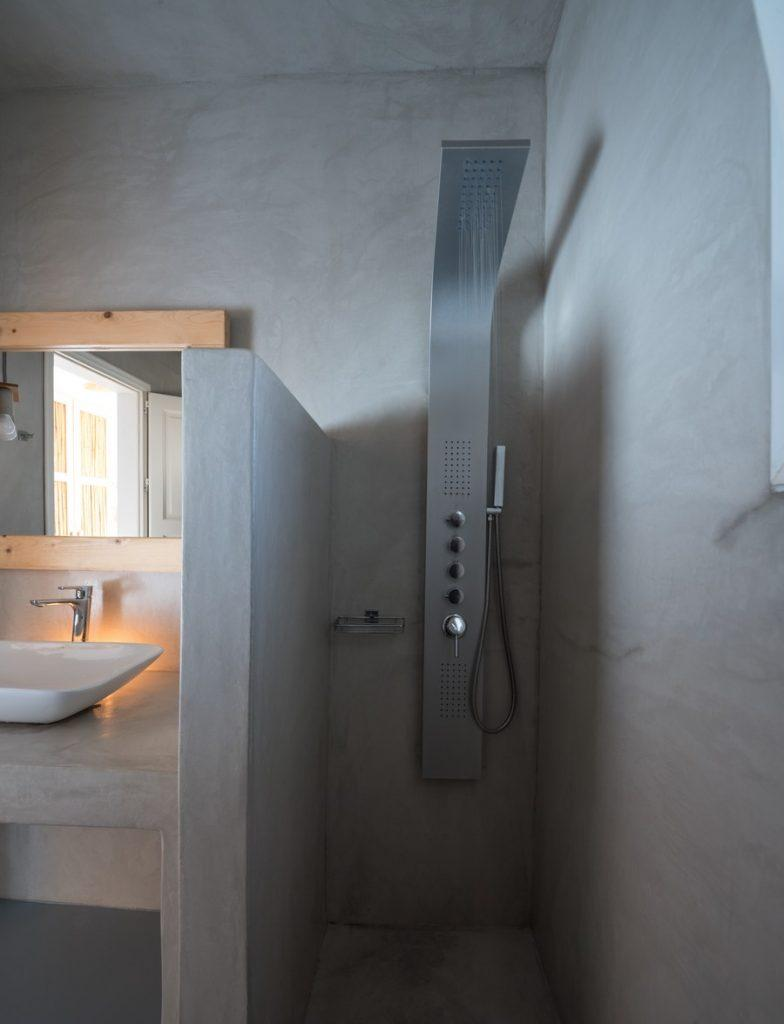 grey wall bathroom with shower and mirror
