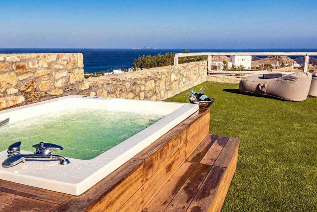 outdoor area with grass surface and jacuzzi