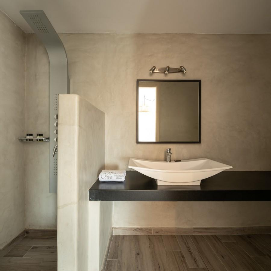 bathroom with towels on the table and open shower cabin