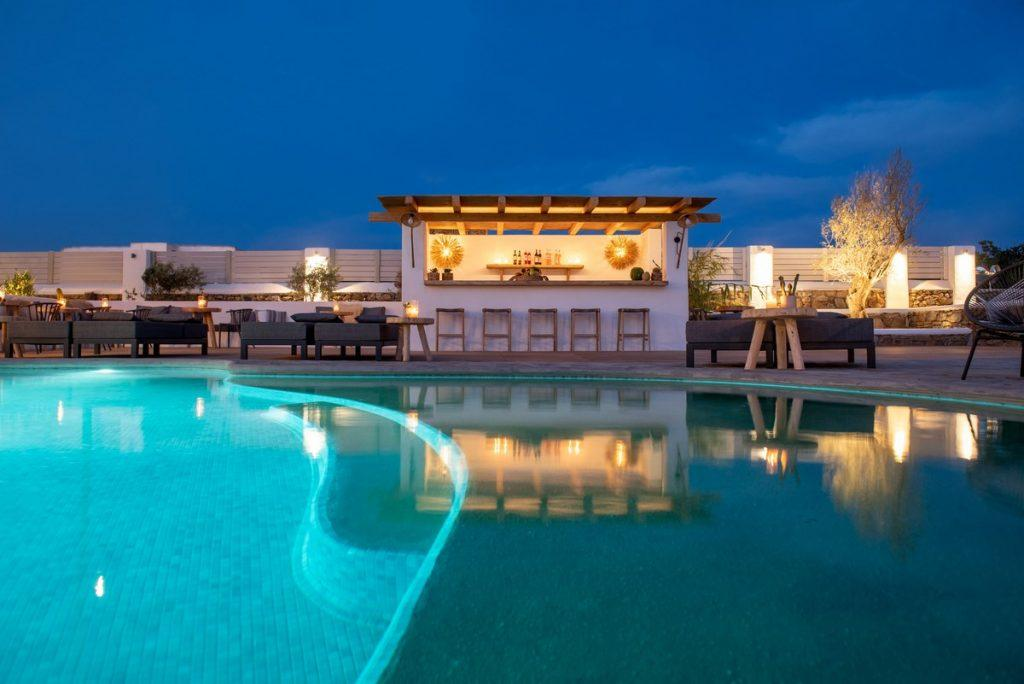 outdoor area with illuminated pool for parties and hanging out