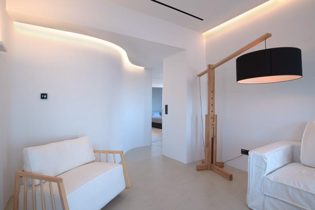 living area for relaxing and interestingly designed lamp hanging out on sofas and armchair and interesting