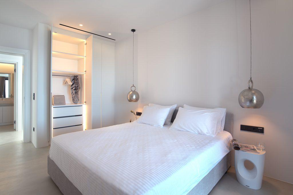 beautifully lit room with cozy bed for resting after hard day