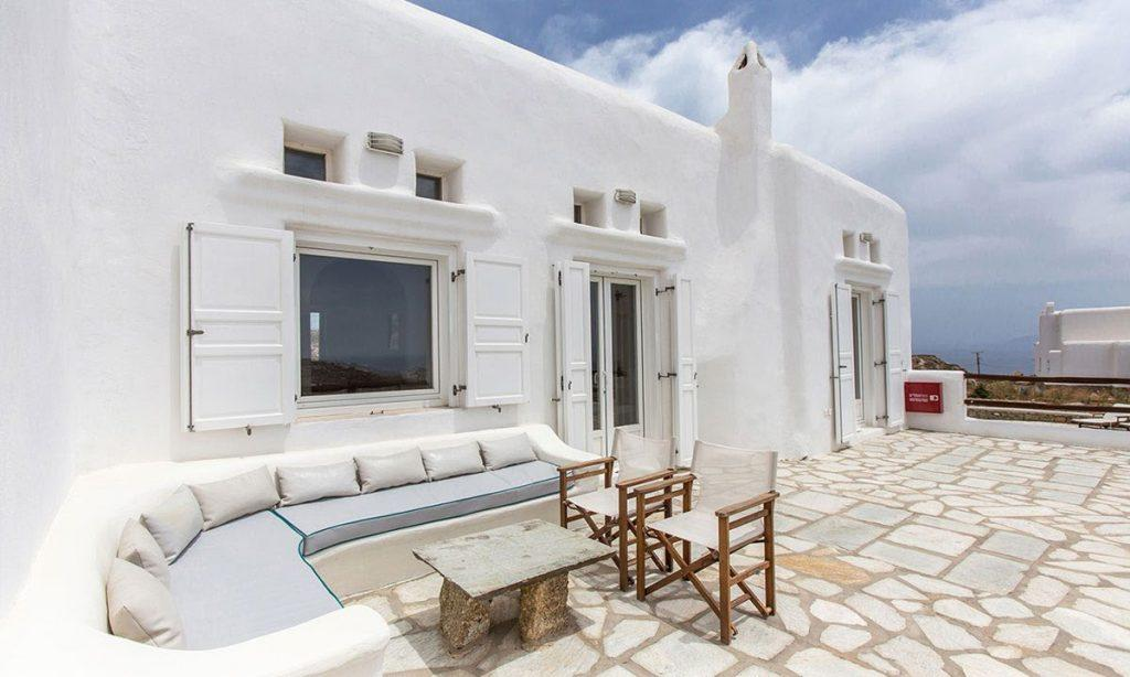 white wall villa with out door sitting area