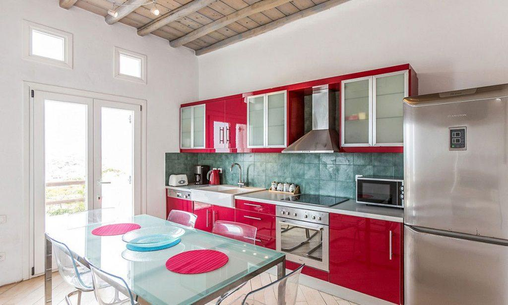 kitchen with red cabins and washstand