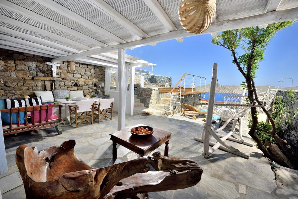 terrace with sea view stone walls and stairs leading to the pool and wicker swing great for enjoying a sunny day