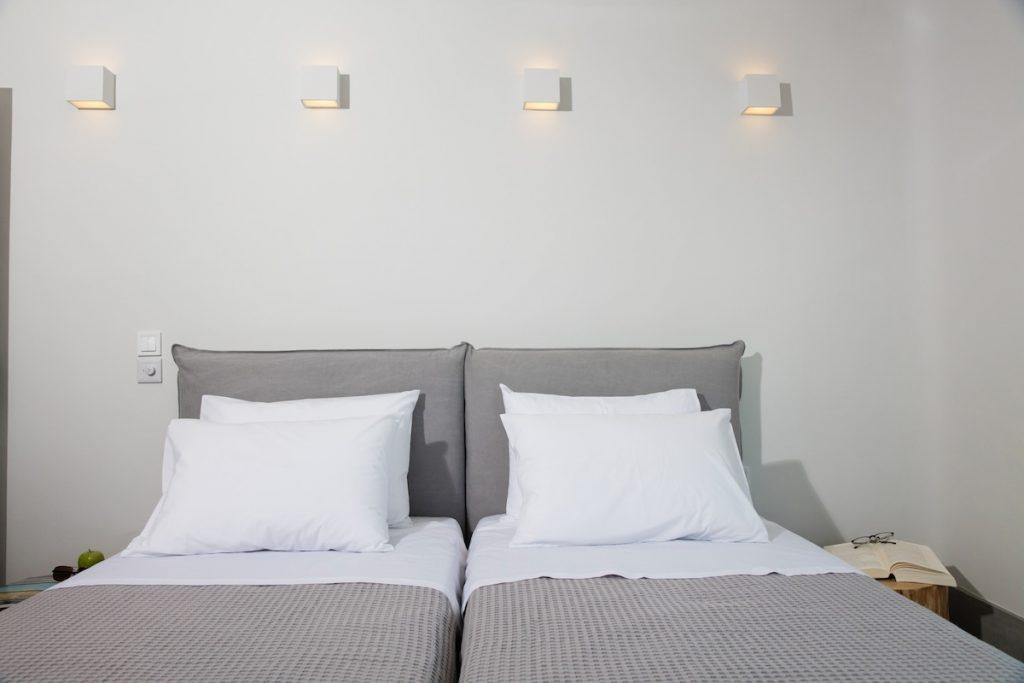 simply designed room with two beds and night lamps