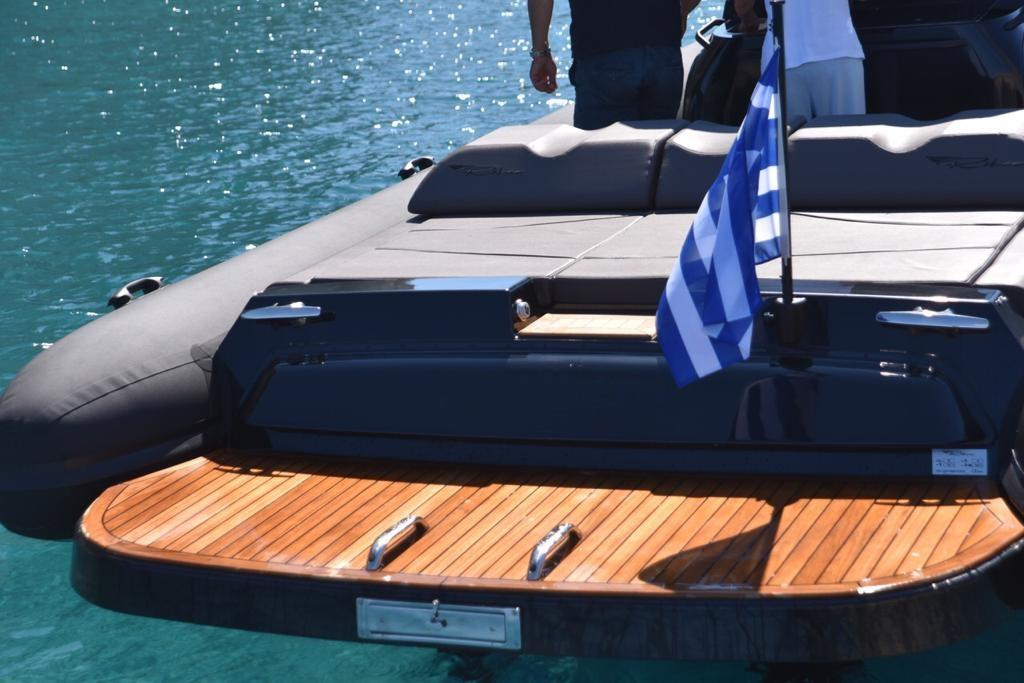 yacht with wooden deck and flag