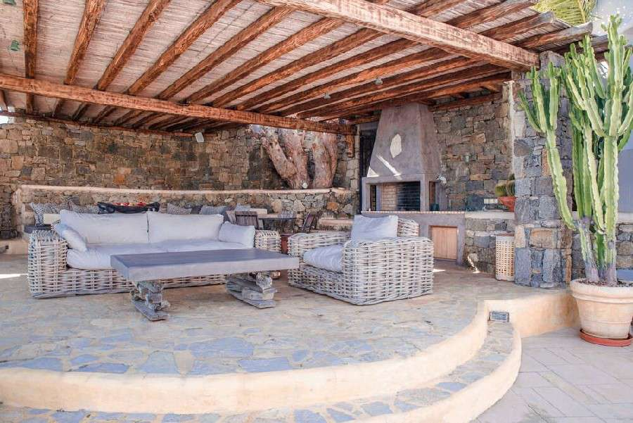 terrace with stone walls and comfortable garden furniture ideal for enjoying a summer day