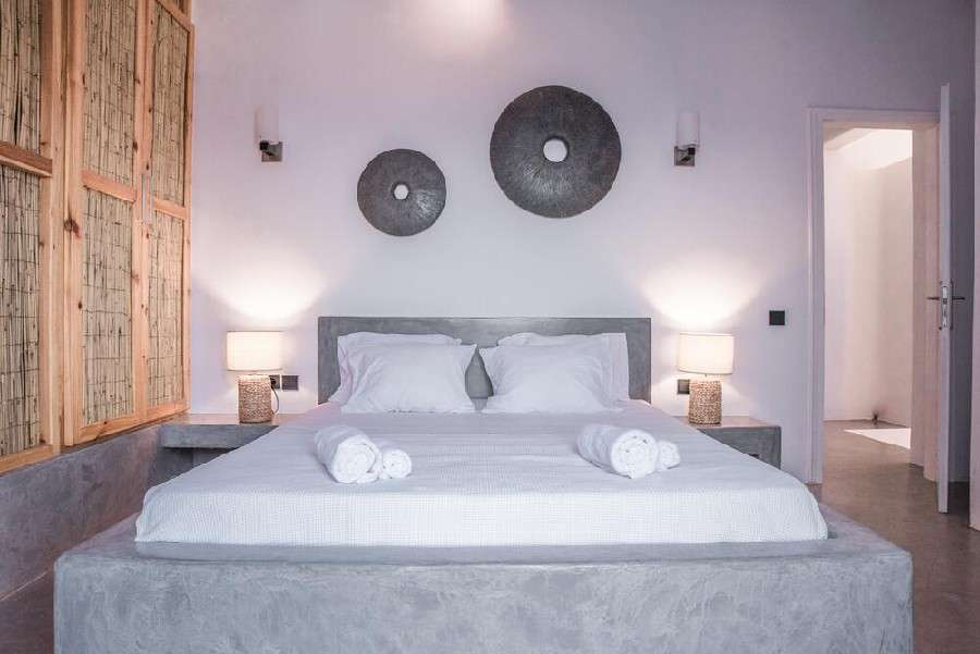 bedroom with white walls and king size bed ideal for resting