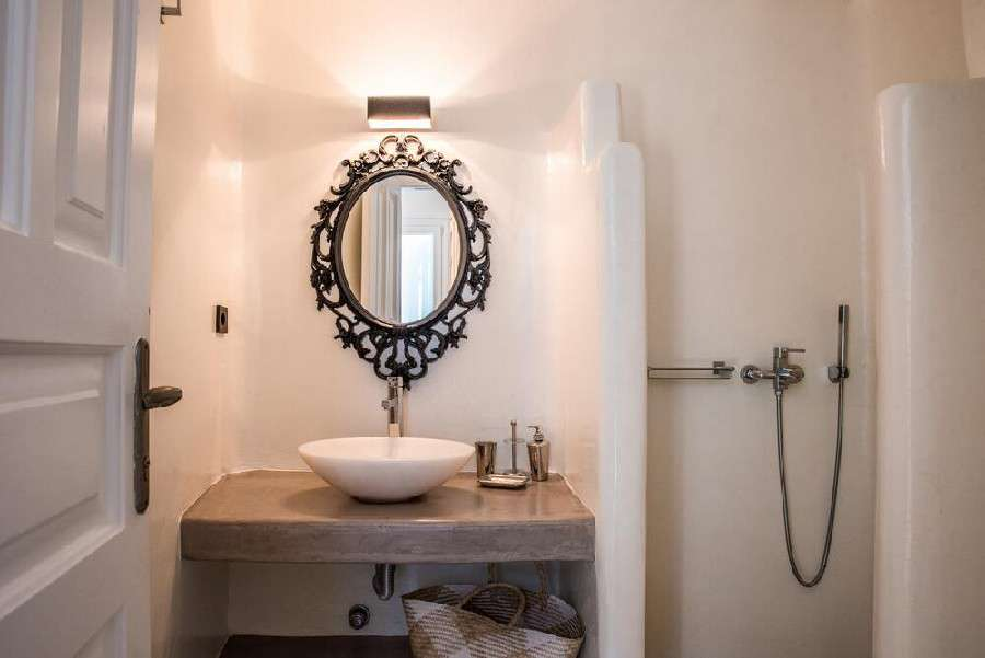 bathroom with white walls equipped with necessary things