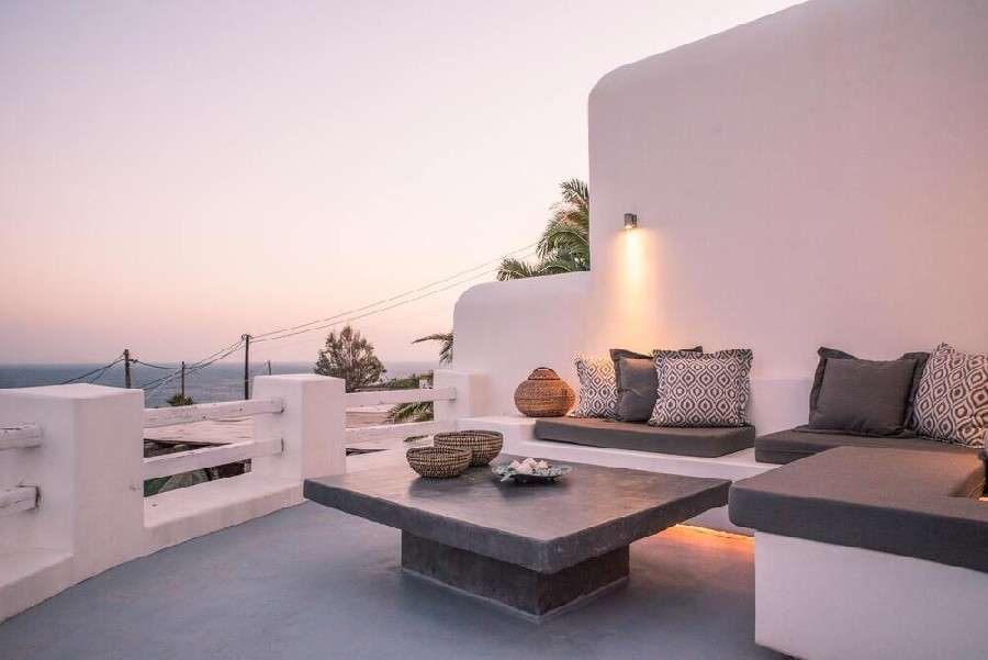 terrace with white walls and comfortable corner furniture ideal for enjoying a summer night