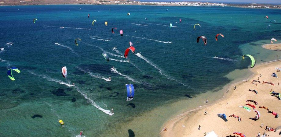 crystal sea with people paragliding