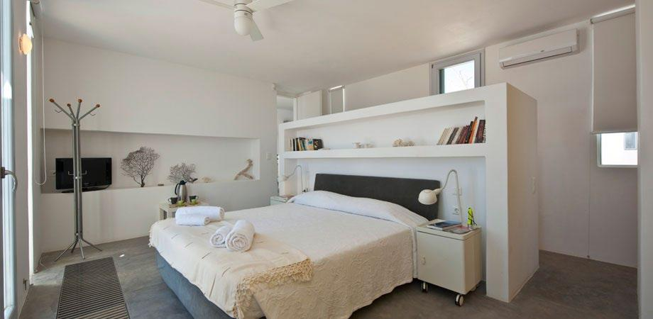 snug and cozy bedroom containing king size bed two lamp nightstands and TV