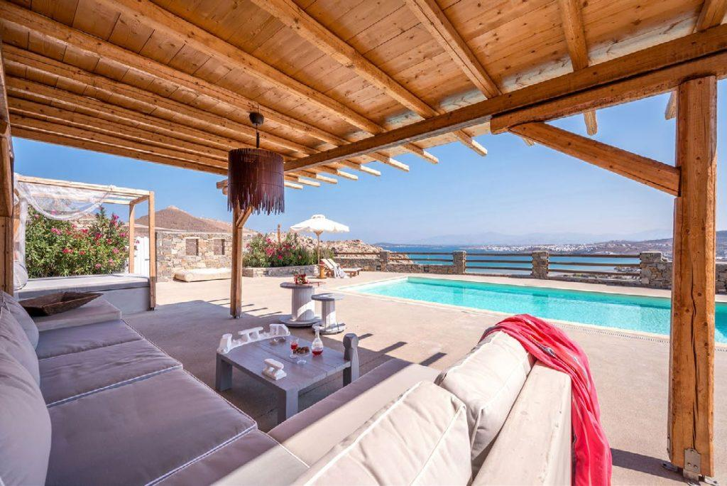 soiree area with cozy sofa with stunning view of sea
