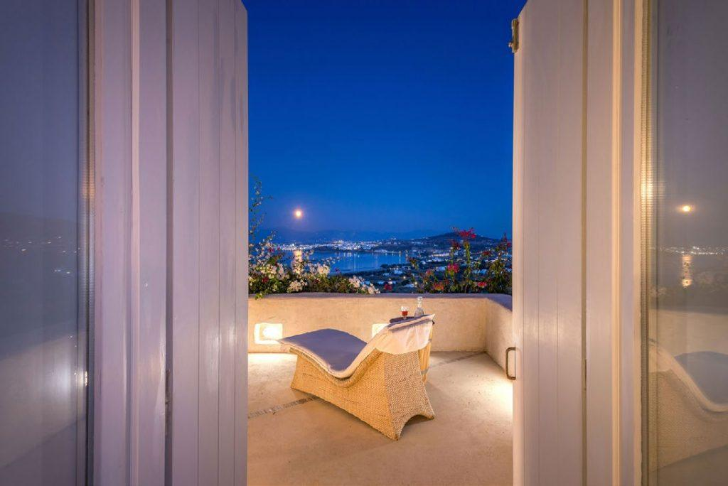 balcony with beautiful look on sea and Mykonos city at night