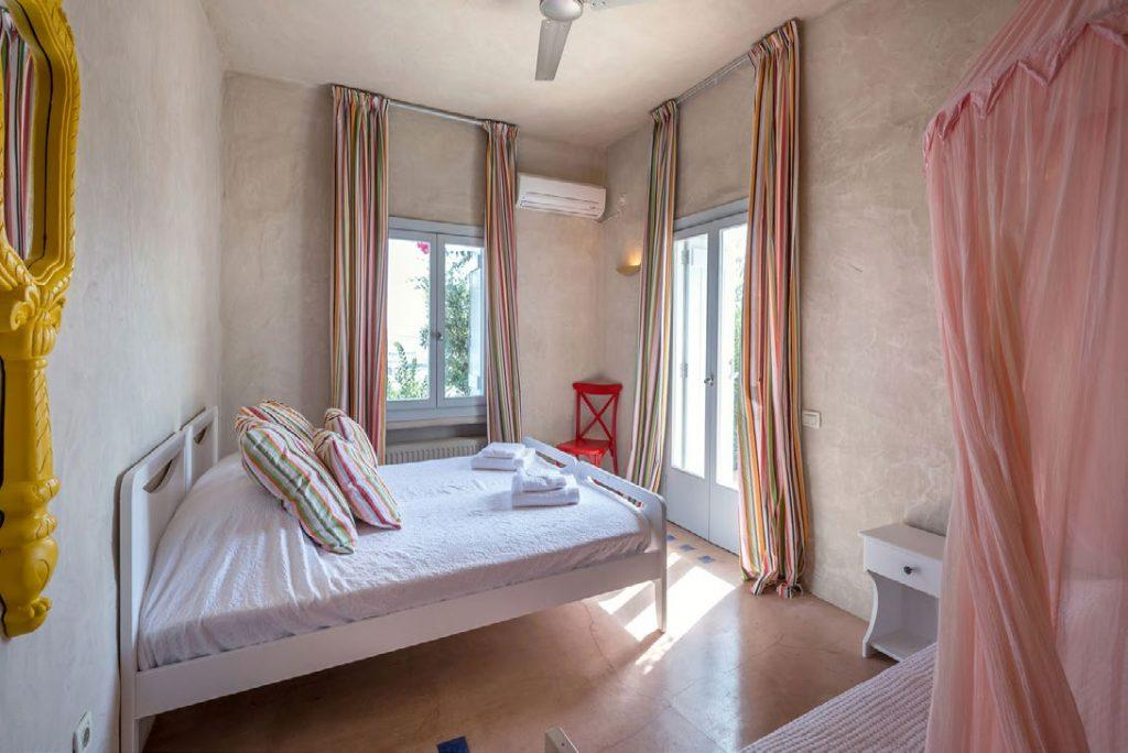 snug double bed bedroom with air condition