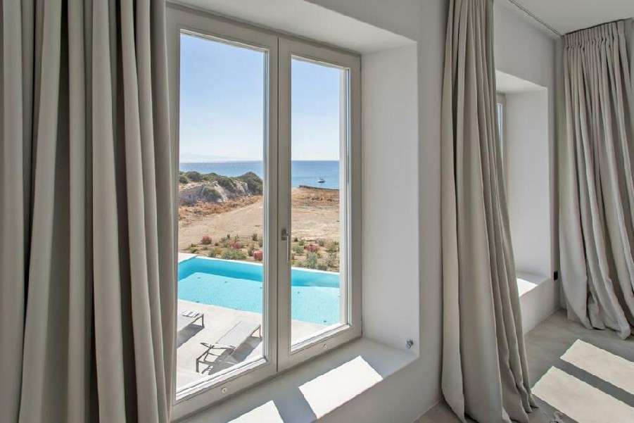 beautiful window view of front yard and pool