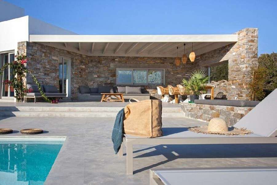 enormous open terrace with dinning table and couches ideal for family and friend gatherings