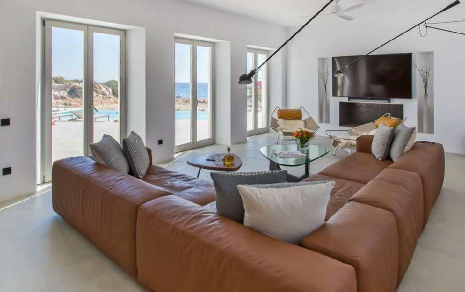 spacious living room with sofa to chill and watch TV