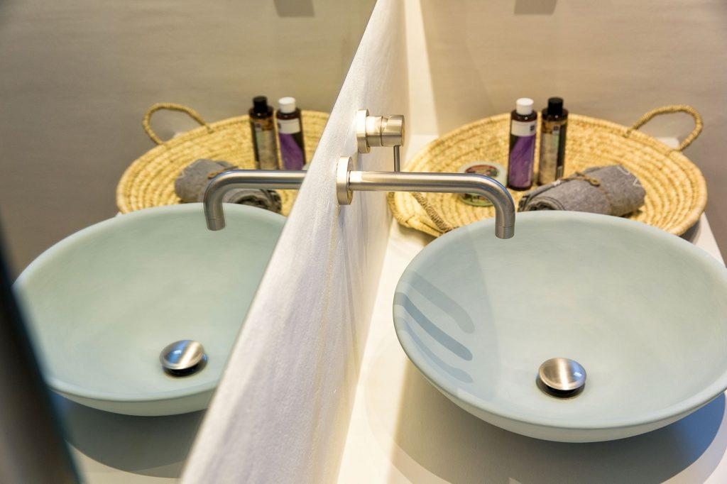 simply designed bathroom with sink and mirror to wash up