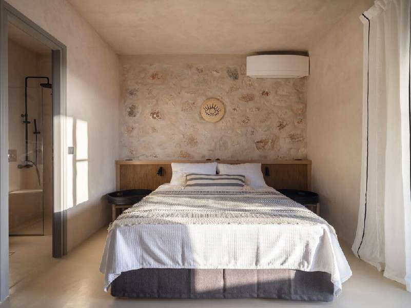 elegantly designed bedroom with air conditioner