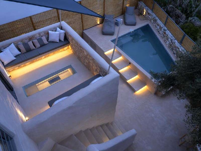 pool area with candles next to pool for romantic night