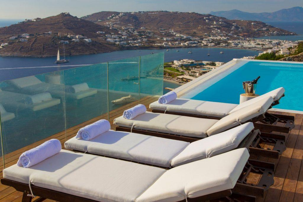 outdoor area with cozy loungers ideal for sunbathing and enjoying a refreshing drink