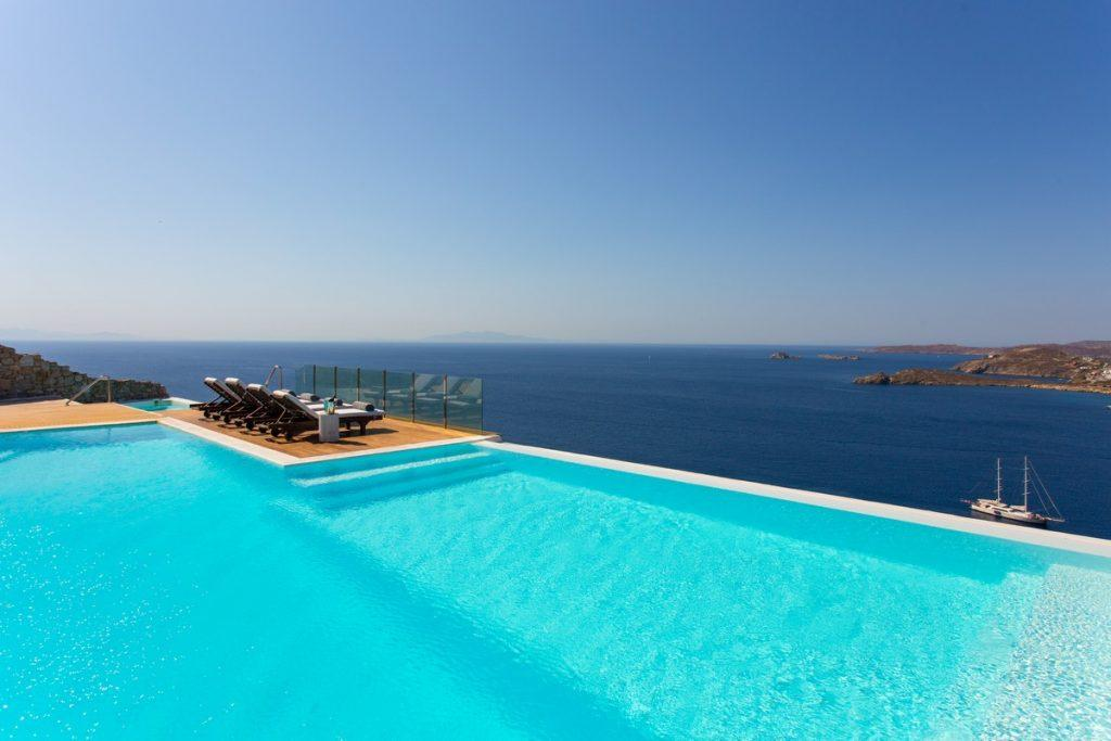 view of the glistening sea from the sun loungers by the pool