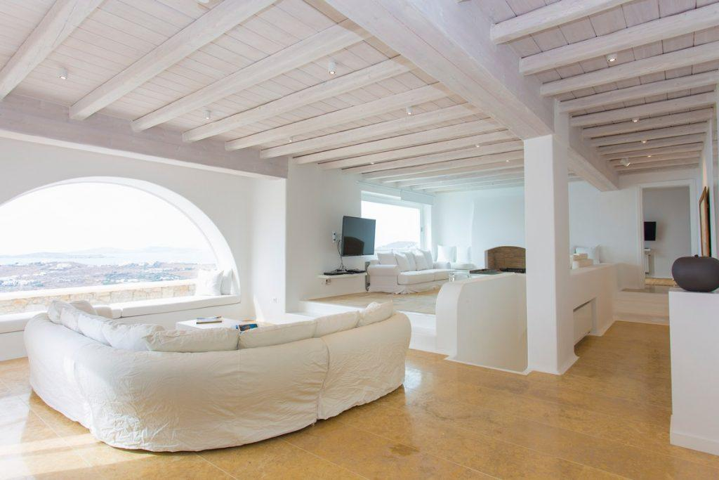 spacious living room with lots of daylight and white furniture