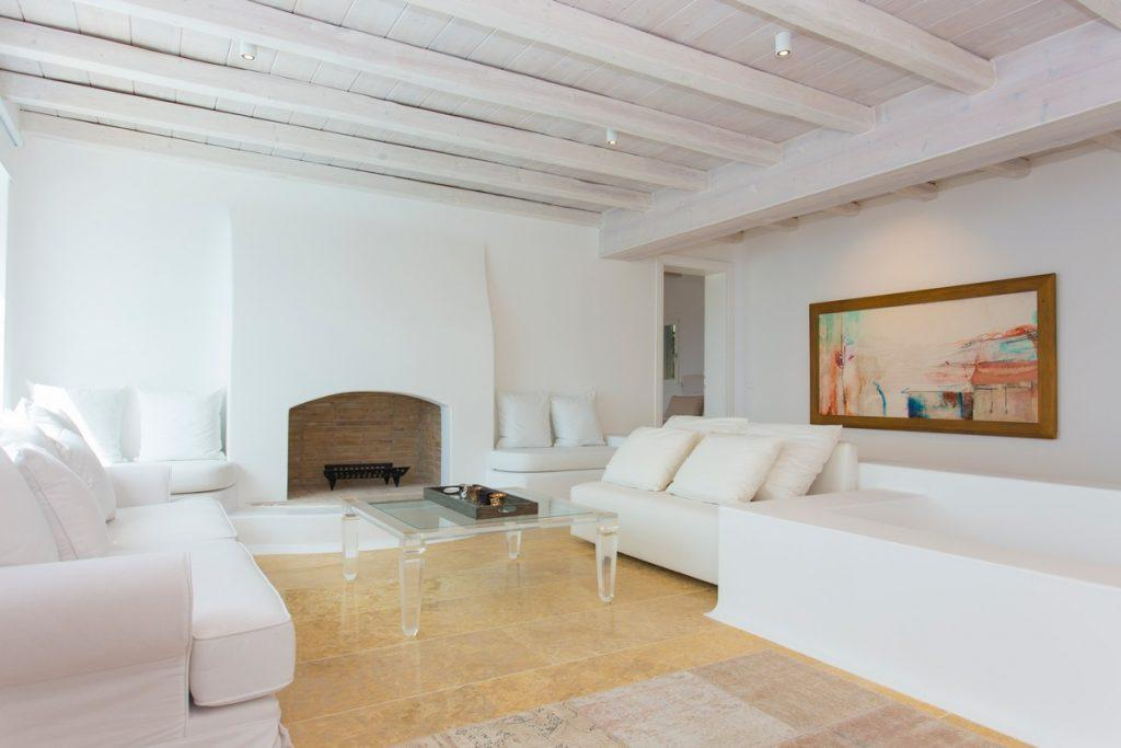 living room with cozy sofa and white fireplace that adds atmosphere