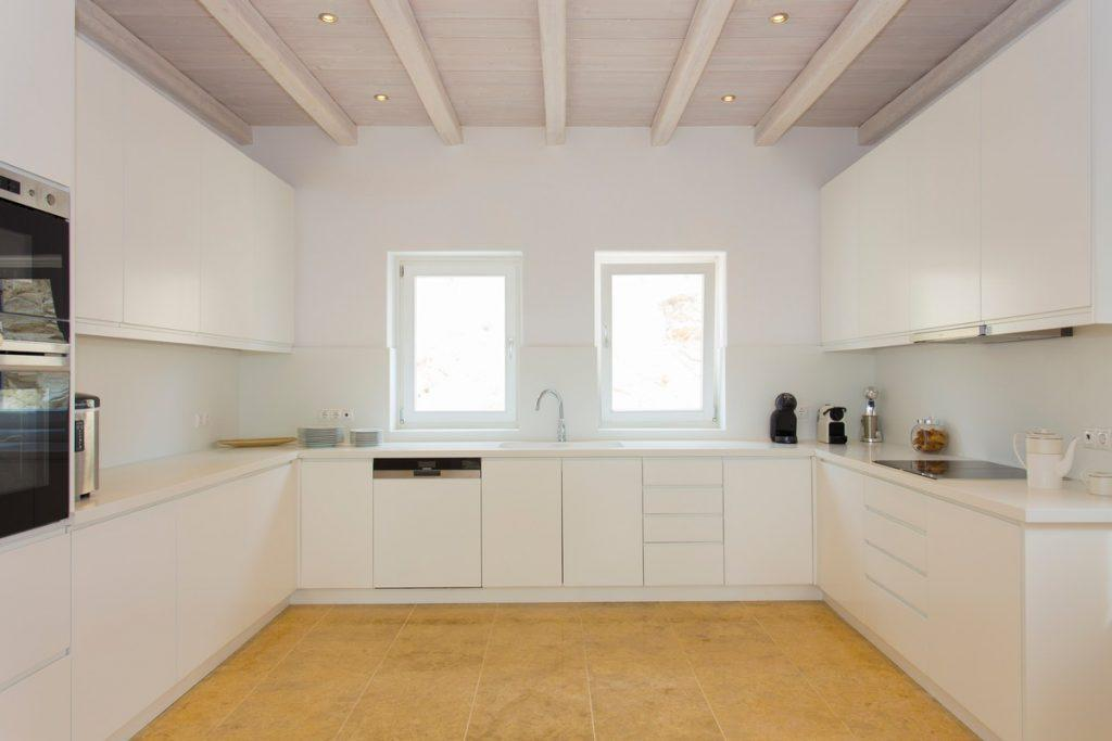 kitchen with white elements and modern appliances