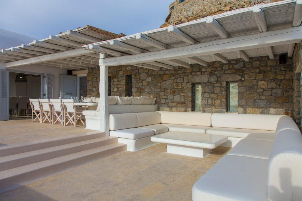 spacious villa courtyard with lunch area and large furniture for relaxing