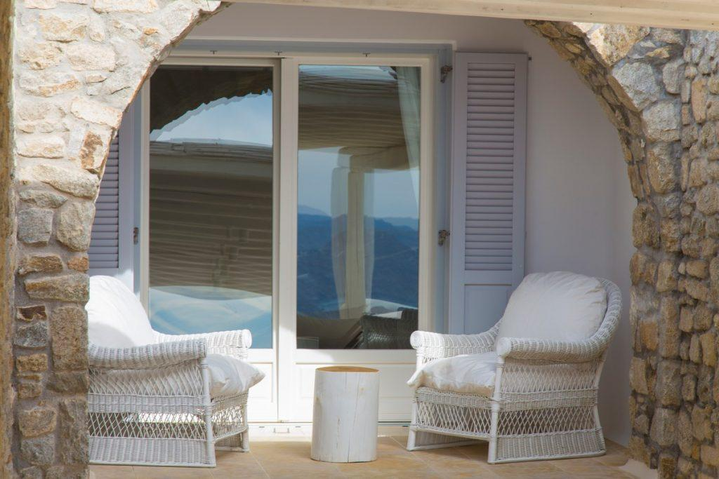 area for relaxing on comfortable white garden armchairs