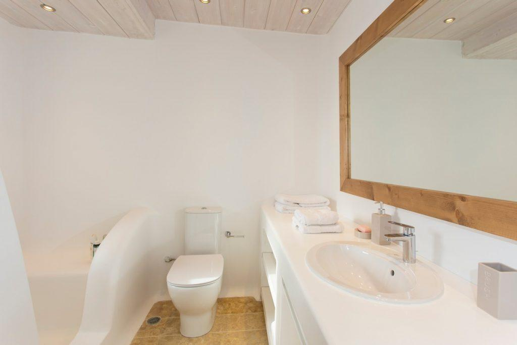 ideal bathroom for two with a large mirror and white sink