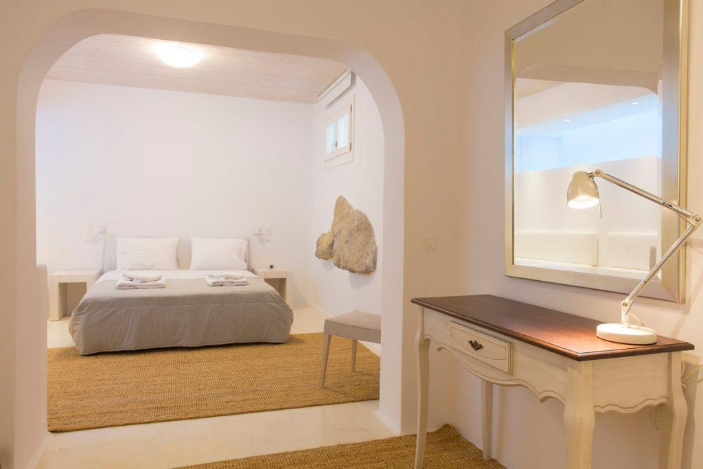 bedroom with white walls and decorative stone details