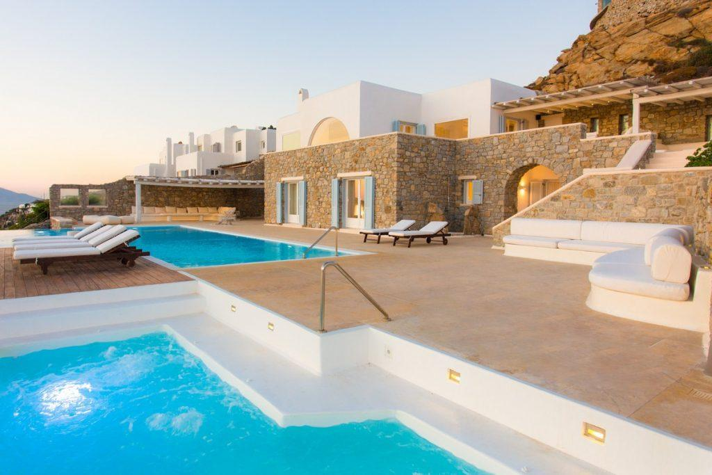 view of a luxury stone villa with a spacious courtyard
