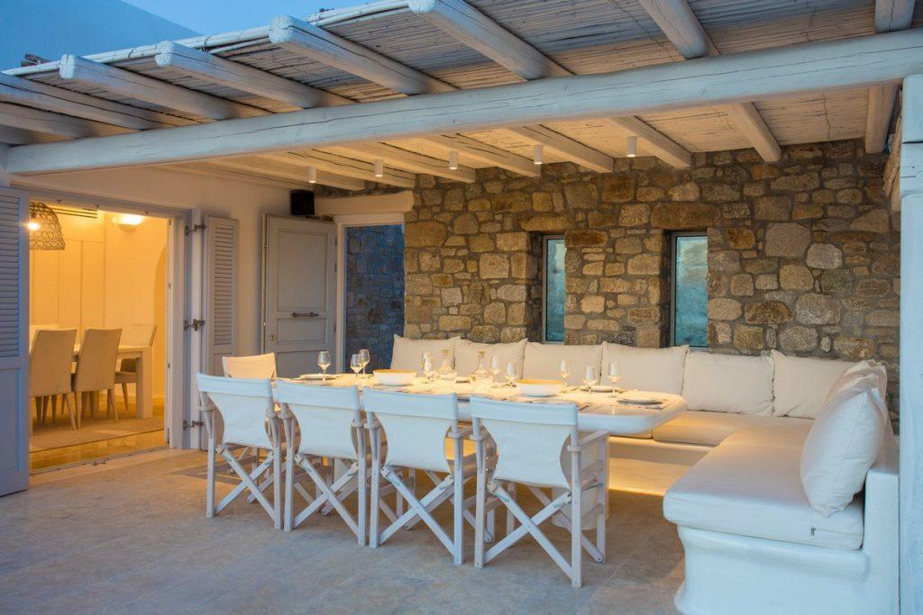 dimly lit terrace in white tone with stone walls