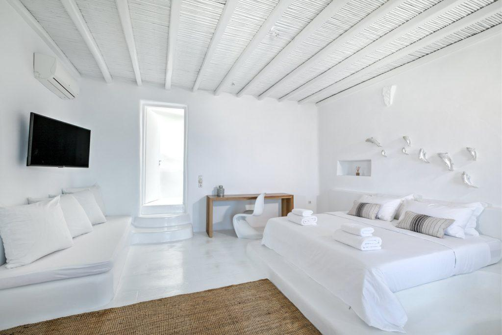 white wall bedroom perfect for relaxing and watching television