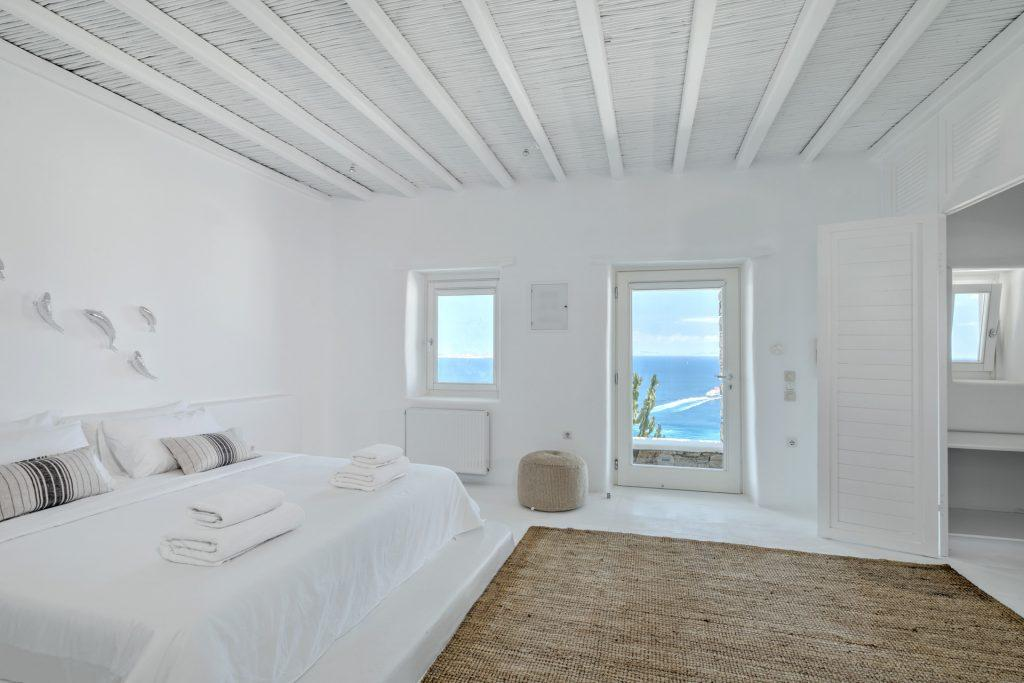 white wall spacious bedroom with breathtaking sea view
