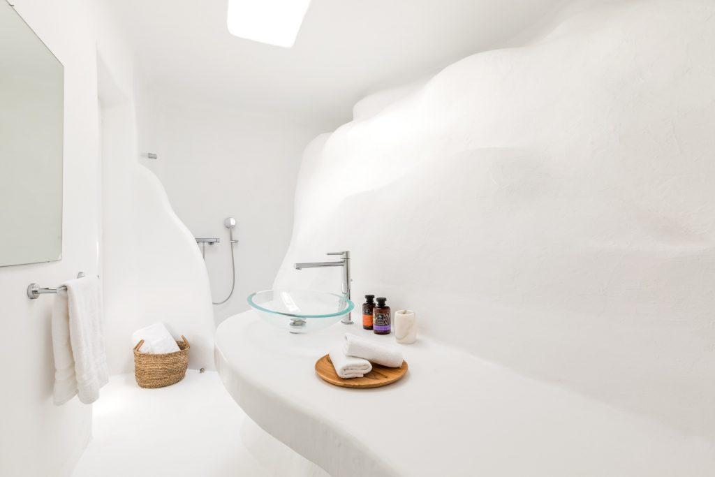 bathroom all in white for showering and cleaning