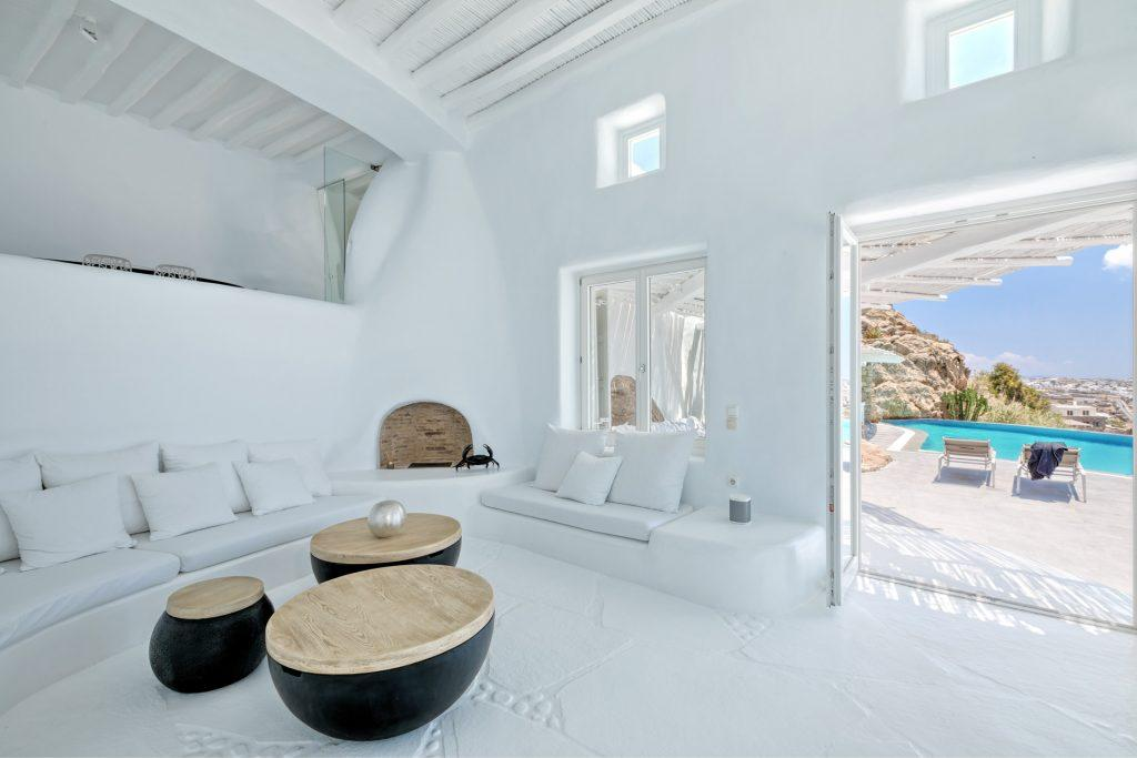 living area with comfortable sofa and wooden tables with satisfyingview