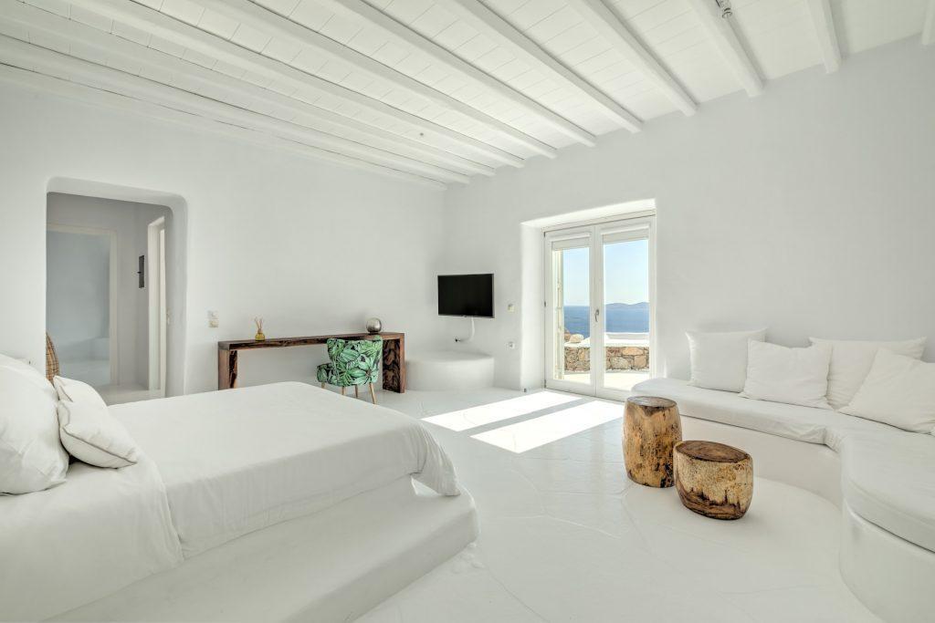 white wall bedroom with adorable sea view from the window