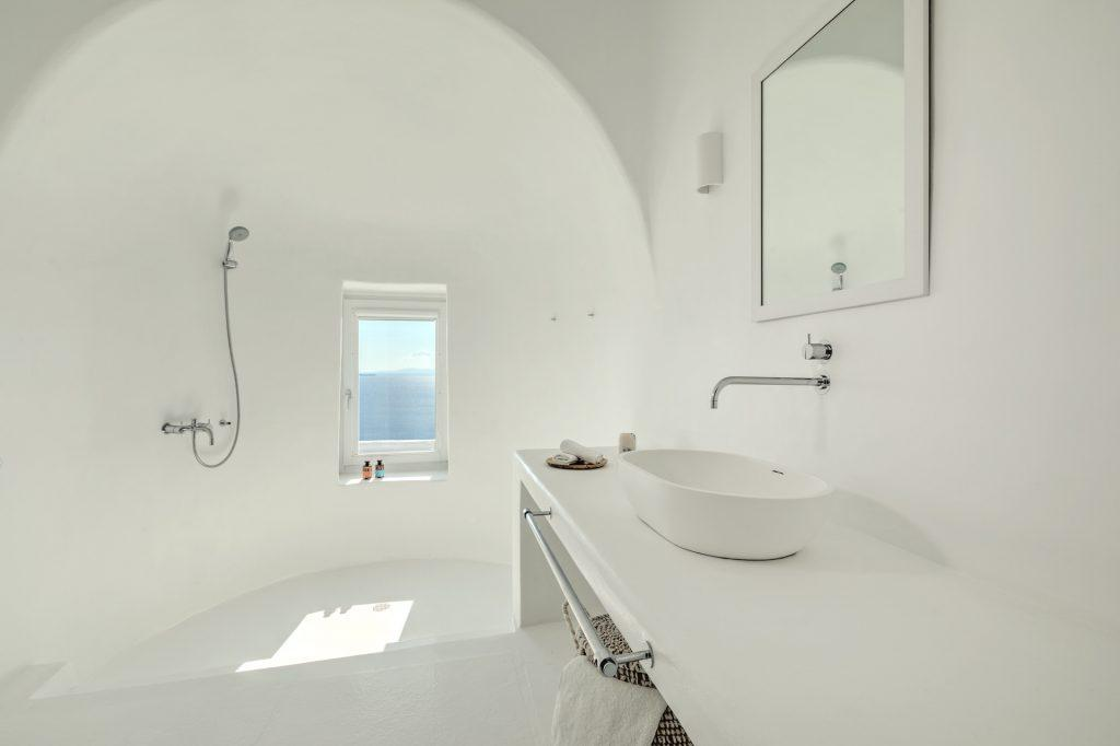 spacious white bathroom for showering and washing up