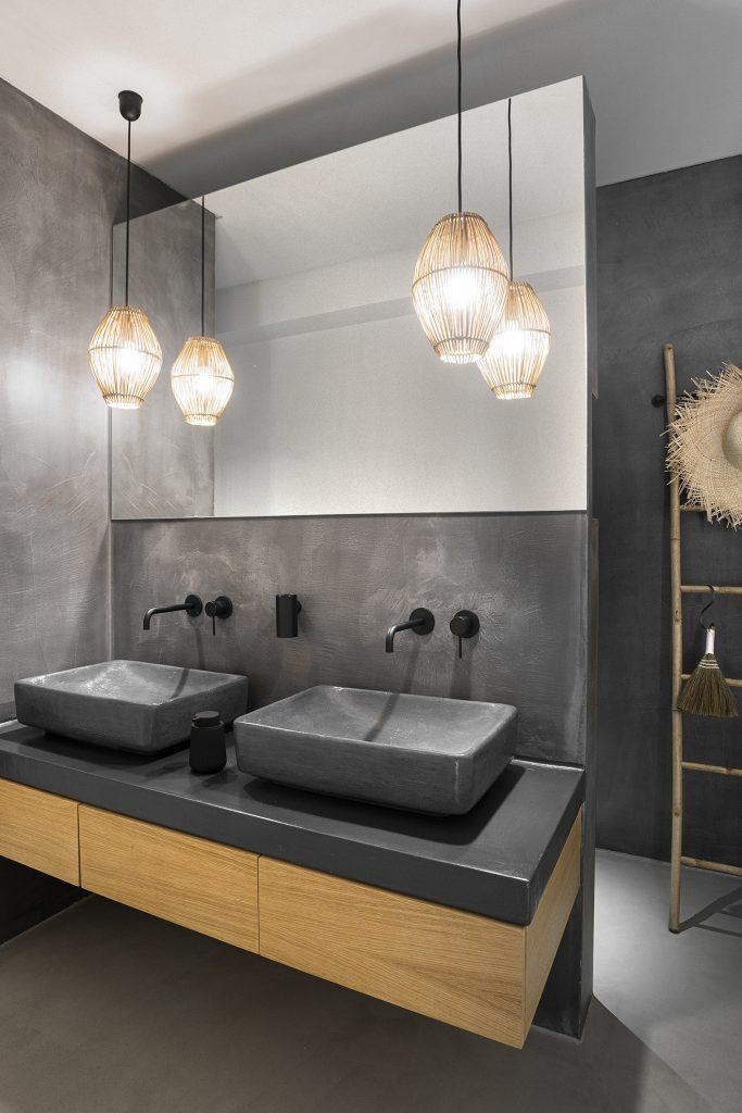 grey modern designed bathroom with huge mirror
