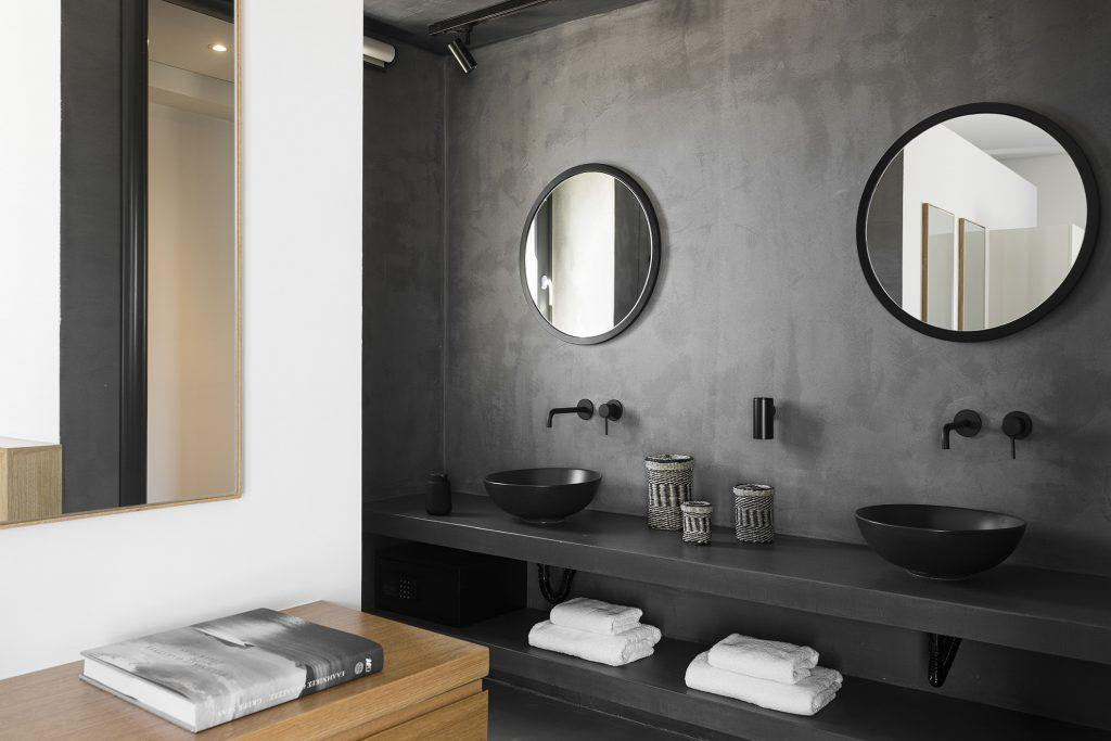 modern minimal style bathroom with black walls