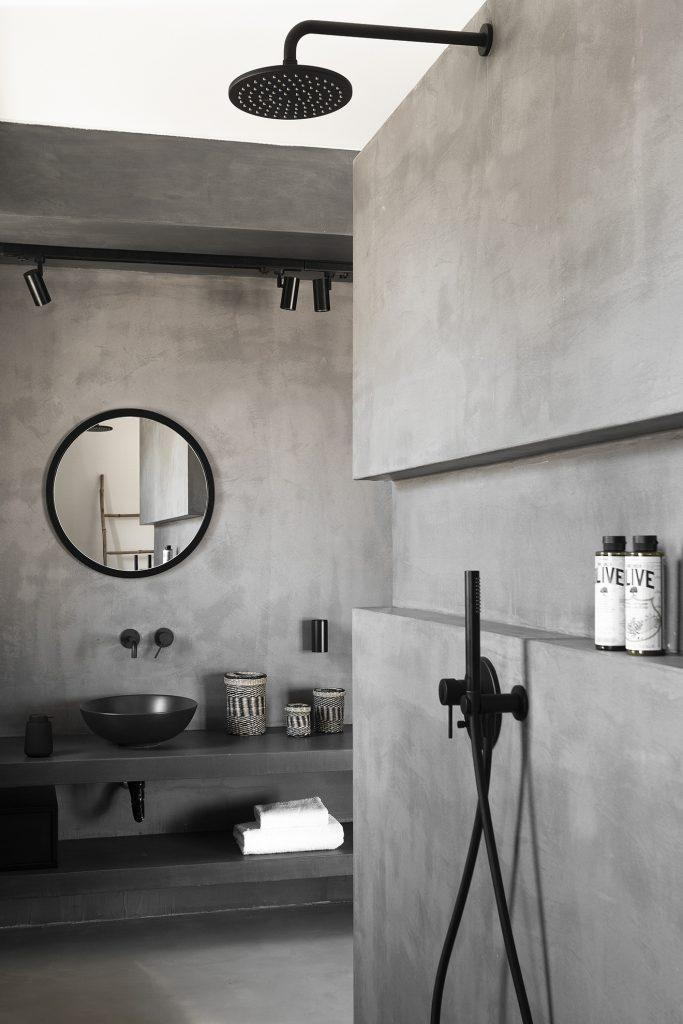 grey wall modern bathroom with black shower
