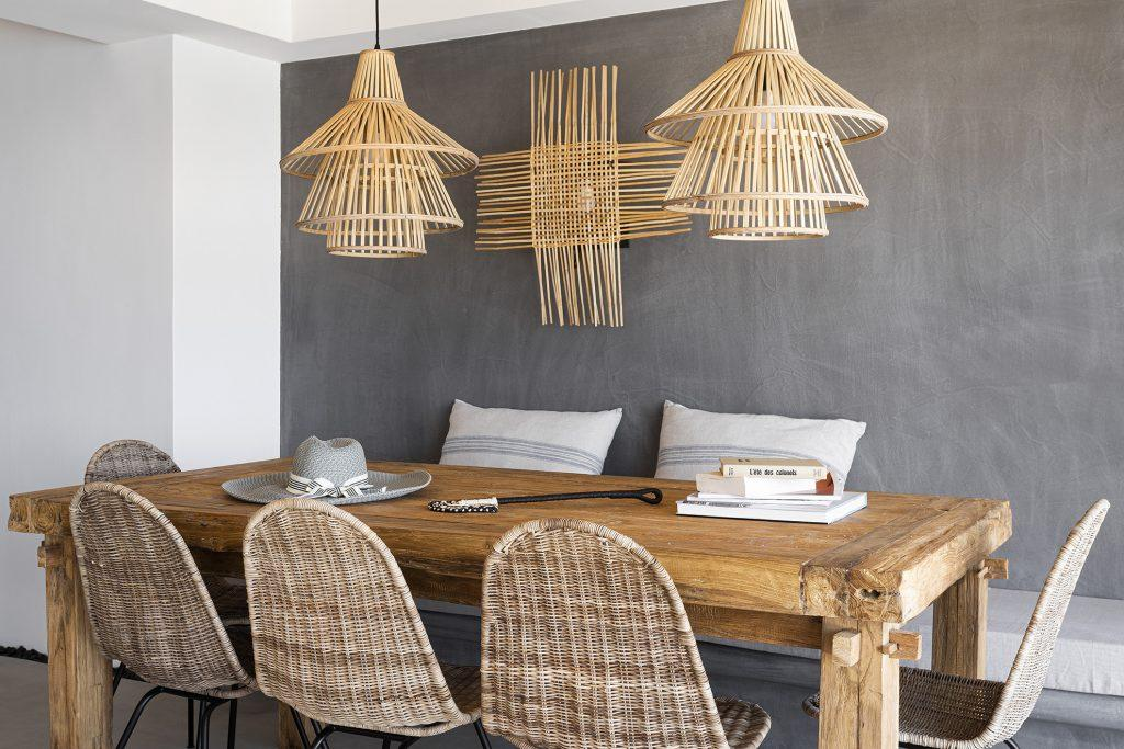 grey wall dining area with wooden table