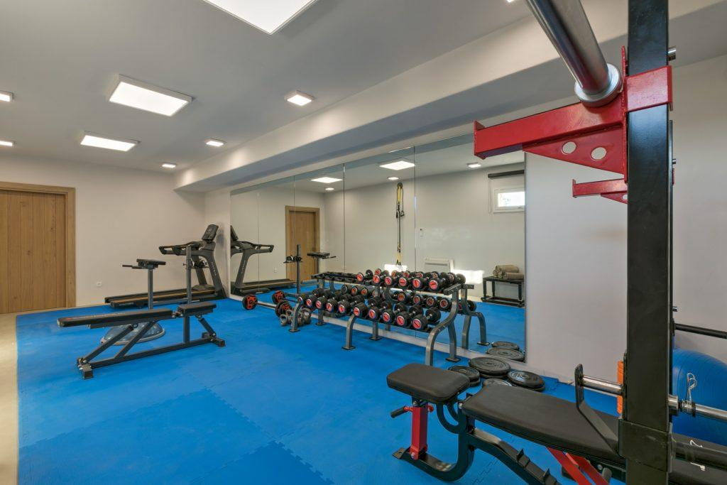 gym with huge mirrors and equip for training