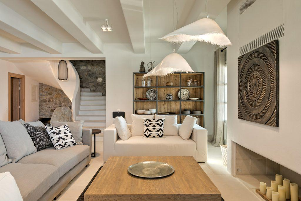living area with unique designed lamps and nice wall paint