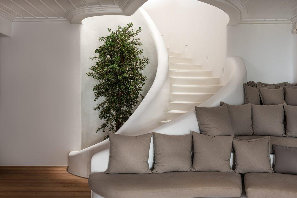 living room wih stairs and lots of soft pillows